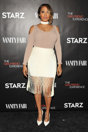 La La Anthony kept the allure coming with a white mesh-overlay pencil skirt.