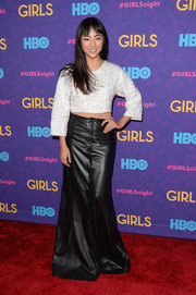 Greta Lee's black leather maxi skirt gave her a boho-meets-edgy feel.