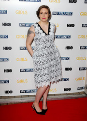 Lena Dunham went the ultra-girly route in a black-and-white lace dress by Erdem during the 'Girls' season 3 premiere in London.