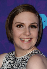 Lena Dunham contrasted her charming 'do with bold eye makeup.