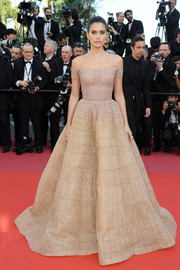 Sara Sampaio looked enchanting in an embellished beige off-the-shoulder gown by Zuhair Murad Couture at the Cannes Film Festival screening of 'Girls of the Sun.'