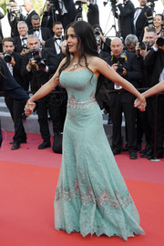 Salma Hayek chose an embellished seafoam-green lace gown by Gucci for the Cannes Film Festival screening of 'Girls of the Sun.'