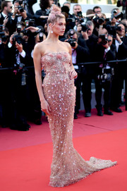 Hailey Baldwin looked lavish in a fully beaded strapless gown by Roberto Cavalli Couture at the Cannes Film Festival screening of 'Girls of the Sun.'