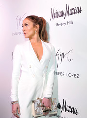 Jennifer Lopez accessorized with a dazzling star-beaded clutch by Valentino at the Giuseppe for Jennifer Lopez launch.
