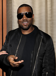 Kanye West is undoubtedly a man of style. He topped off his all black look with dark aviator shades.