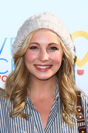 A white knit beanie added some fun to Candice Accola's casual get-up at the Golden Globes Giving Lounge.