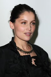 Laetitia Casta paired her black ensemble with a gold link necklace.
