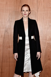Karen Elson showed off a perfectly tailored black coat at the Givenchy fashion show.