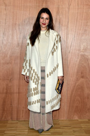 Margherita Missoni arrived for the Givenchy fashion show all bundled up in a wool coat, a knit top, and a striped maxi skirt.