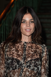 Julia Restoin-Roitfeld wore her hair with a center part and lots of volume at the Givenchy fashion show.