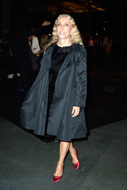 Franca Sozzani was vintage-chic at the Givenchy fashion show in an evening coat layered over an LBD.