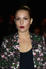Noomi Rapace pulled her back in a classic bun for the Givenchy fashion show.