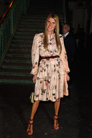 Anna dello Russo looked uncharacteristically demure in a long-sleeve peach butterfly-print dress at the Givenchy fashion show.