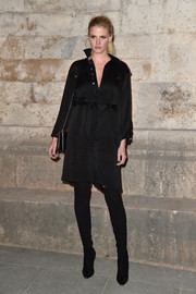 Lara Stone was edgy-chic in a long-sleeve black shirtdress while attending the Givenchy fashion show.