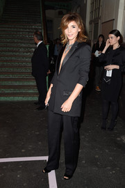 Clotilde Courau looked impeccable in her black tux during the Givenchy fashion show.