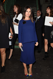Miroslava Duma kept it simple yet classy in a long-sleeve blue maternity top at the Givenchy fashion show.