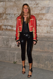 Anna dello Russo contrasted her edgy jacket with a sexy pair of sequined capri pants.