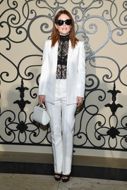Julianne Moore looked impeccable in a crisp white suit, which she punctuated with a sheer black lace top, at the Givenchy Spring 2018 show.