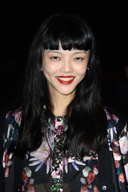 Rila Fukushima attended the Givenchy fashion show wearing her hair loose with blunt bangs.