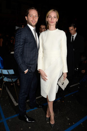 Lauren Santo Domingo was sleek and elegant in a long-sleeve white dress during the Givenchy fashion show.