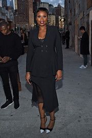 Jennifer Hudson styled her suit with black-and-white ankle-strap pumps.