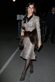Carine Roitfeld looked fiercely chic in a biker-style snakeskin skirt suit during the Givenchy fashion show.