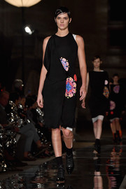 Kendall Jenner walked down the Givenchy runway wearing a draped kaleidoscope-print dress.