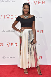 DJ Kiss worked the crop-top trend at the NYC premiere of 'The Giver' with this black off-the-shoulder number.