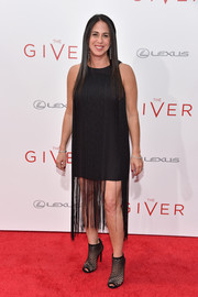 Nikki Silver went the edgy route with a pair of black mesh peep-toe booties.