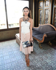 Cara Santana looked summer-ready in a white tube top with a strappy back during the Glam App's Glamchella.