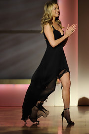 Jen Aniston was sexy in a black chiffon frock paired with strappy sky-high sandals.