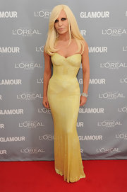 As expected, Donatella brought the glamour to the Glamour Women of the Year Awards in a strapless yellow beaded gown.