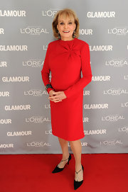 Barbara Walters wore a red long-sleeve dress with a lovely shoulder gather detail for the 2011 Glamour Awards. Black heels, dangling earrings and a cuff bracelet were her only accessories of choice.