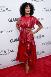 Tracee Ellis Ross matched her dress with pointy red pumps by Jimmy Choo.