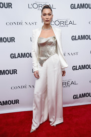 Bella Hadid punctuated her whites with a beaded silver corset top, also by Cristina Ottaviano.