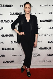Coco Rocha teamed her suit with black and gold cap-toe slip-ons.