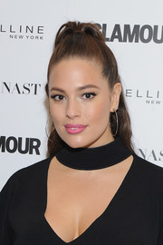 Ashley Graham attended the Girl Project event wearing her hair in a half-up style.