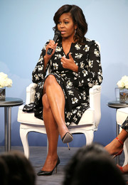 Michelle Obama charmed in a floral wrap dress by Proenza Schouler during Glamour's 'A Brighter Future' event.