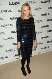 Tory wore a horizontally striped blue sequined cocktail dress. She paired this with black tights and platform strappy heels. Her hair was kept simple chic.