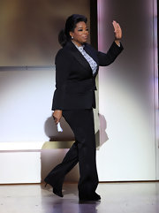 Oprah looked svelte in a well-tailored black suit.