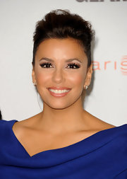 Eva Longoria emphasized her lips with a glimmering peachy-pink lipstick at the 2011 'Glamour' Reel Moments event.