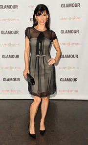 Perrey Reeves looked chic on the red carpet at the 'Glamour' soiree in a black and white cocktail dress topped off with classic black stilettos.
