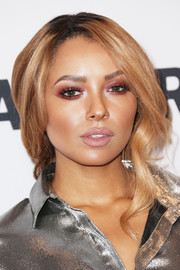 Kat Graham went for a bold beauty look with a smoky application of purple eyeshadow.