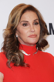 Caitlyn Jenner got all prettied up with these shoulder-length curls for the Glamour Women of the Year 2016.