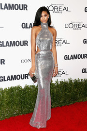 Chanel Iman matched her shiny frock with a mirrored box clutch.