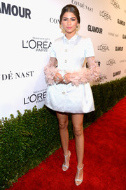 Zendaya Coleman complemented her dress with a pair of Swarovski crystal-embellished T-strap sandals by Giuseppe Zanotti.