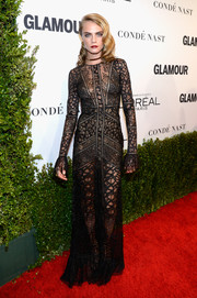 Cara Delevingne sent temperatures rising with this sheer black gown by Elie Saab at the Glamour Women of the Year 2016.