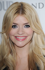 Holly Willoughby balanced heavy eyeliner with petal pink lipstick.