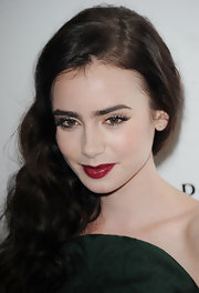 With those red lips and famous brows, there's little argument that Lily Collins really is the fairest one of all.