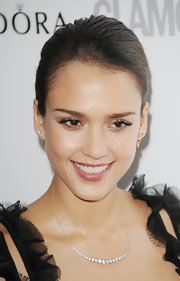 By sweeping her hair back into a sophisticated bun, Jessica Alba kept the focus on her dewy complexion.